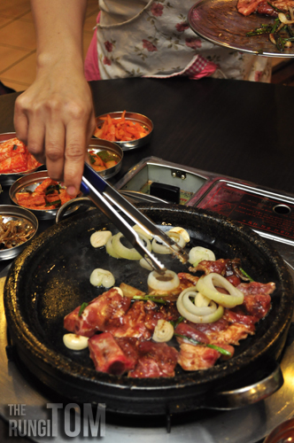 cooking the pork Bintulu Korean Restaurant, Lintas Plaza