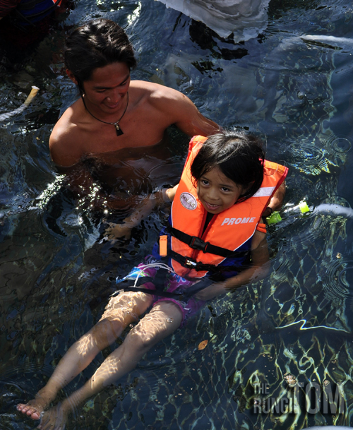 staff guiding a kid to swim My Waterworld: Borneo Reef World
