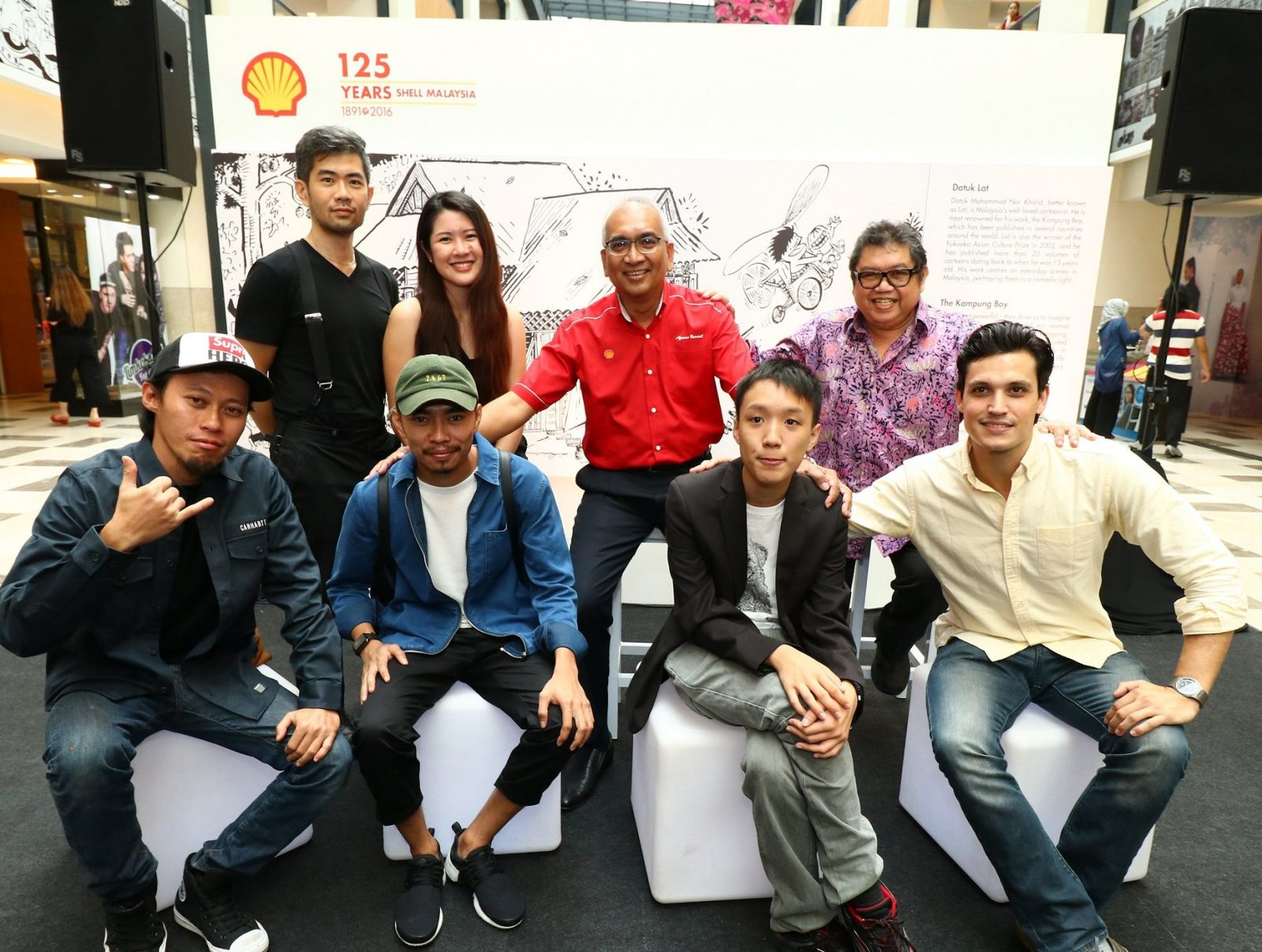 Datuk Azman Ismail, Managing Director, Shell Malaysia Trading Sdn. Bhd. and Shell Timur Sdn. Bhd. (second from right, top row) with the artists who are part of the Celebrating 125 Years art project. Left to right (top row): Cheeming Boey, Caryn Koh, Datuk Lat; Left to right (bottom row): Dmojo, Amey Sheikh Ali, Yap Hanzhen and Tom Powell. Photo: shell.com.my